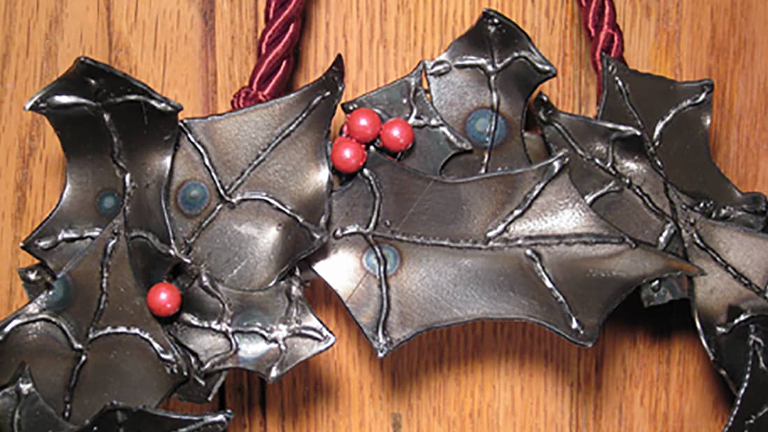steel holiday wreath with holly