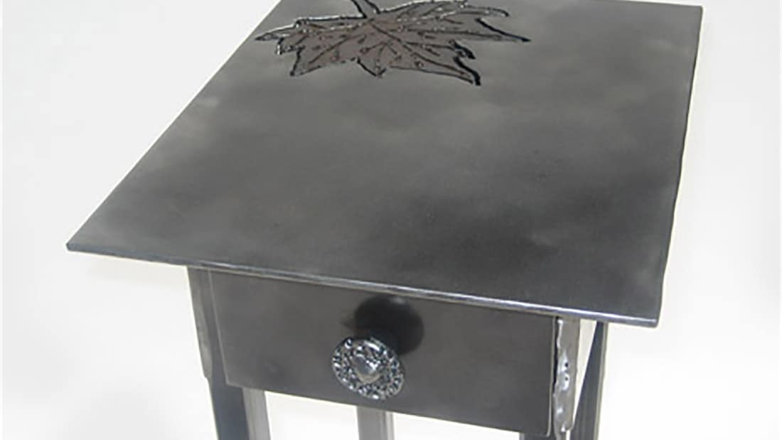 steel side table with leaf design