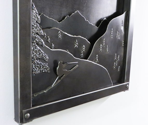 metal artwork with mountains