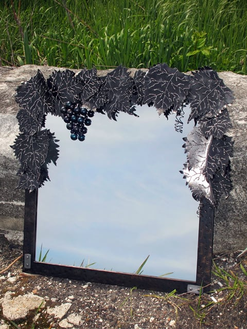 metal mirror with grapevine