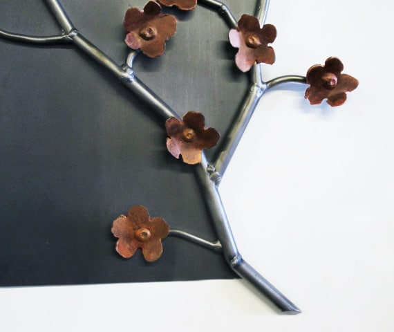 steel artwork with flowers