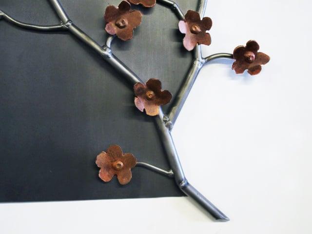 steel artwork with flowers
