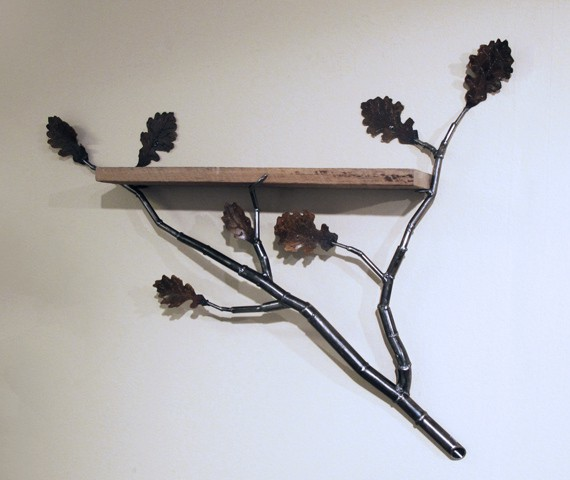 metal shelf with branches and leaves