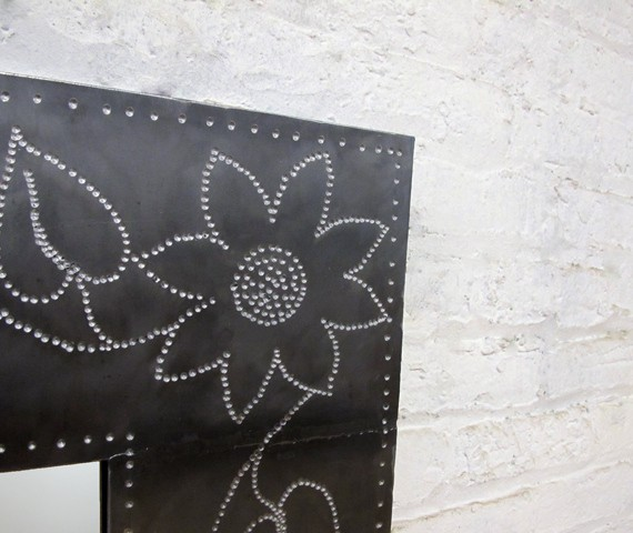 steel mirror with punched flower design