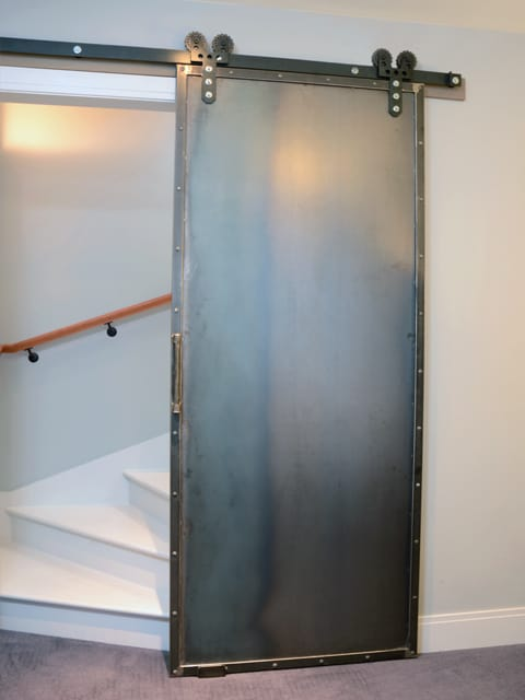 Riggo design riveting steel barn door for Metal barn doors