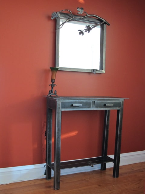 steel console table with leaf design