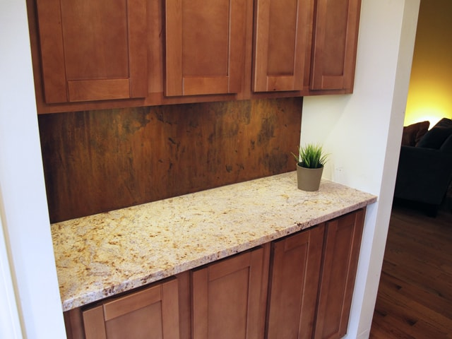 steel backsplash with natural rust patina