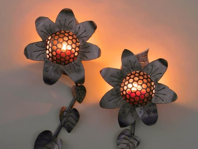 steel sunflower sconces with candles