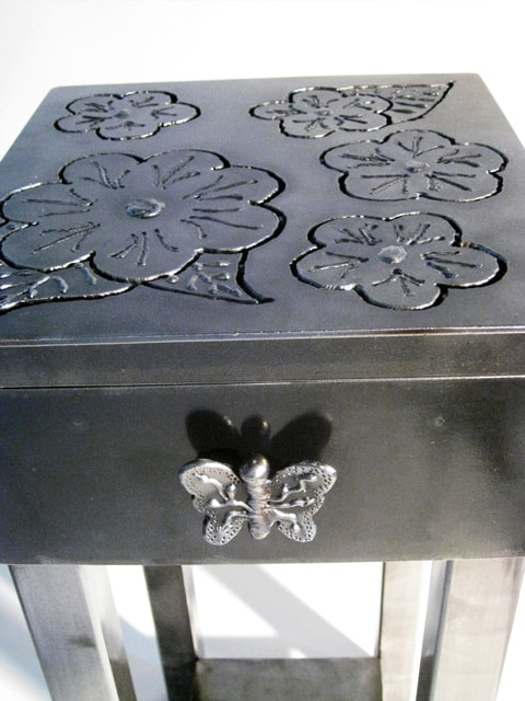 metal end table with flowers