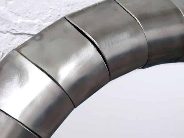 round brushed steel mirror